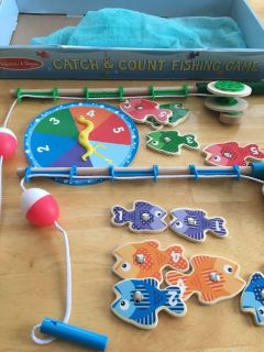 Melissa and Dough fishing game with spinner and all pieces shown - easy pick up $10