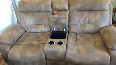 Reclining love seat with cup holders and counsil
