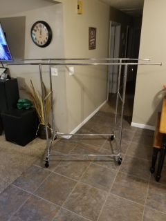 Double clothes rack with expandable sides and collapsible for storage. FCFS. PICKUP TODAY