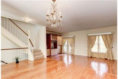Light filled 3 level townhouse with 2 master bedrooms on 2nd floor. Parking Available!