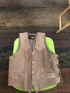 Unisex leather vest. Dark beige. Size L. Ties on side for sizing.Great for motorcycle riding. Worn ONCE. PPU ONLY
