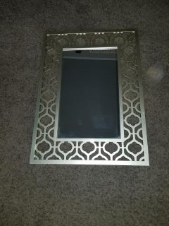 Gold framed mirror..26 x 19 inches