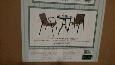 Three piece indoor/outdoor table and chairs
