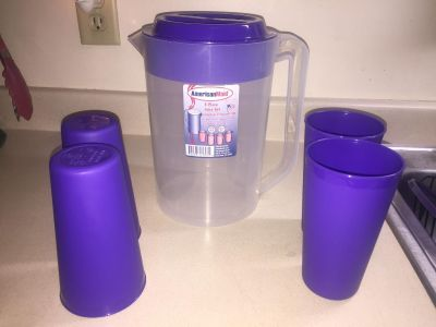 One gallon pitcher, and four Tumblers brand new