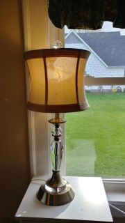 """Crystal Lamp. 26"""" brass tone with beige shade."""