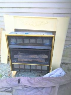 gas wall fireplace (mantle as shown in photo included)