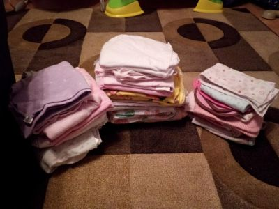2 stacks of receiving blankets and burp cloths