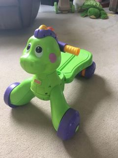 Singing dinosaur walker and can ride on
