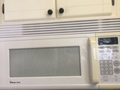 WHITE BUILT IN MICROWAVE OVER THE STOVE