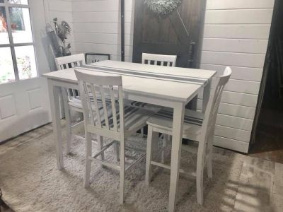 High top table set with 4 matching chairs