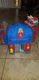 Tranformer optimus prime fire station with fire truck and fireman