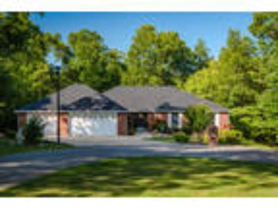 Spacious Beauty in Wooded Lakeside Subdivision