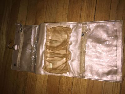 Goldish taupe travel pouch that hands. Tag says holiday hair. Looks in great shape not sure if ever used.