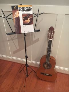 Guitar, case, music stand and book 1