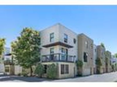 Luxurious Tri-Level Townhouse with Balcony and Garage in NOBE