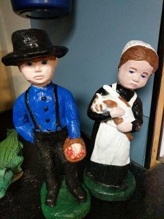 Pair of garden statues of boy and girl and kitten $100.