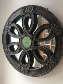 Round mirror with woodwork and glass insert