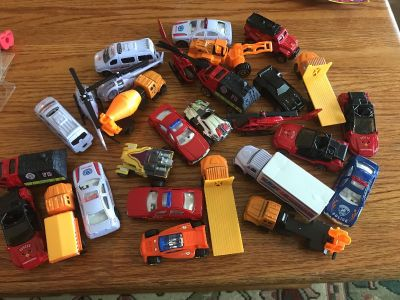 Lot of cars helicopters trucks