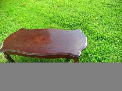 Cute brown table,21 inches wd,47 1/2 inches lg,18 inches tall