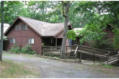 Wonderful rental home in awesome private wooded setting!