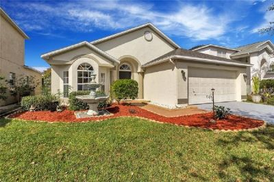 Beautifully situated along the golf course of the gated Remington Golf Community.