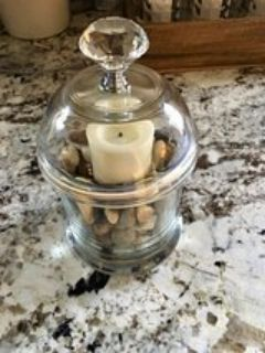 Home decor candle holder with candle, pebbles
