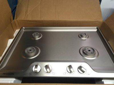 $499, New Scratch  Dent Frigidaire 30 Gas Cooktop in Stainless Steel