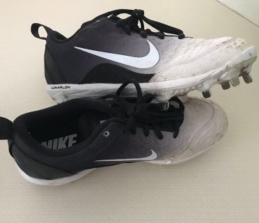 Size 8, brand new woman s metal softball cleats