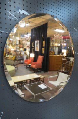 Vintage Art Deco peach round wall mirror, c. 1930.