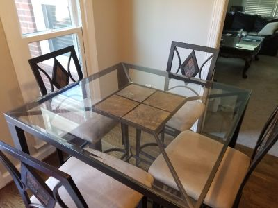 Counter height glass table and chairs with matching baker's rack