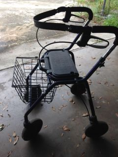 Walker with handbrakes and seat & basket