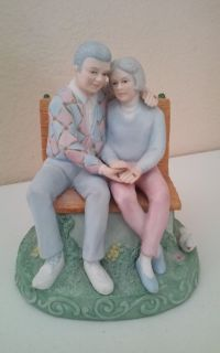 Man & Woman Sitting on Bench Musical Figurine