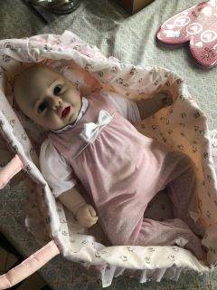 Realistic baby doll