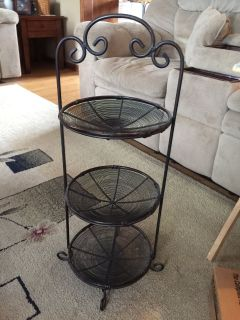 Three tier wrought iron display stand