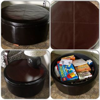 Leather storage ottoman with reversible wooden table top.