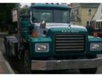 1996 Mack RD-Roll-Off Truck in New Hyde Park, NY