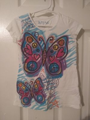Very cute top size 4 good condition