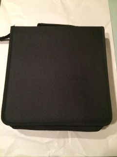 Zippered cd holder. Black. With inserts.