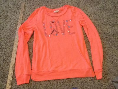 Women's size Large light weight sweatshirt in GUC with VERY, VERY light wash wear $2.00.