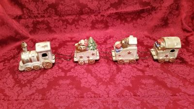 Excellent condition very unique ceramic Christmas train! It is filled with many amazing Christmas novelties!