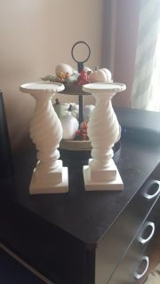2 white candle holders