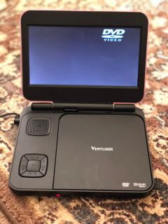 Portable DVD player. 7 screen. Comes w/wall and car charger, and case.