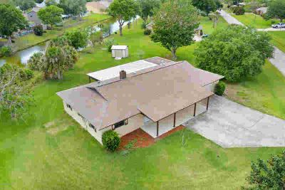 1033 Orange Woods Boulevard Rockledge Three BR, Unique country