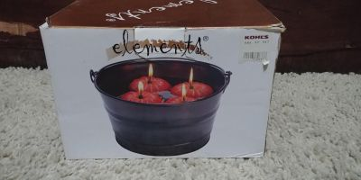 New floating pumpkin candles in bucket 3.00