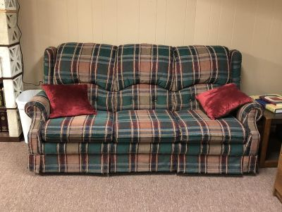 Gently used plaid sleeper sofa. Queen size bed folds out. See close up pictures!