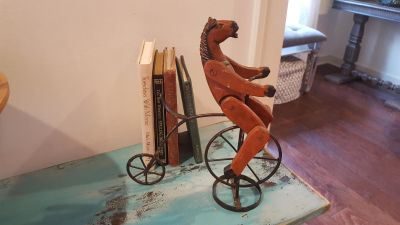 """Vintage Repo Wooden Folk Art Horse riding a Penny-Farthing. Great Whimsical Piece. 10"""" L x 4"""" W x 11"""" H. Horse is Wooden. Bike is Iron."""
