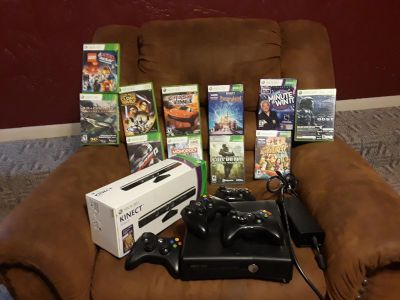 Xbox 360 w/ Kinect, 12 games and 4 controllers!