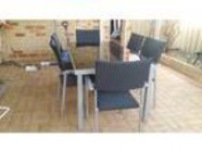 Outdoor setting acirc glass table with matching chairs
