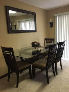 Very nice glass top wooden table and (4) chairs dining room set. Smoke free home.