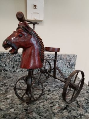 Toy Horse tricycle made of wood on a metal frame
